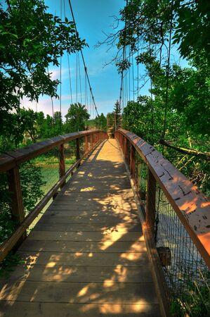 HDR Photo of a Suspension Bridge Over a River Stock Photo - 5035066