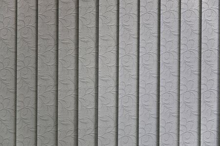 Vertical blinds textile pattern sun lit from behind  Stock Photo
