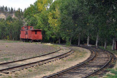 Old abandoned train left on railroad tracks