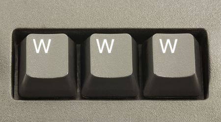 domains: WWW internet concept on a computer keyboard Stock Photo