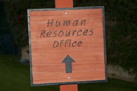 Outdoor sign pointing to Human Resources Offices Stock Photo