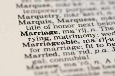 Extreme close up of the word MARRIAGE found inside a dictionary