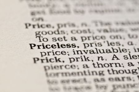 priceless: Extreme close up of the word PRICELESS found inside a dictionary