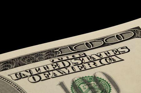 Macro shot of a corner of the US $100 bill