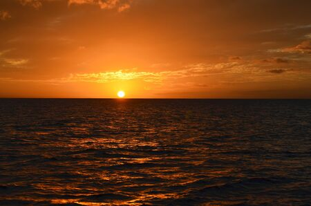 Golden Sunset Landscape Over Pacific Ocean Waters Stock Photo
