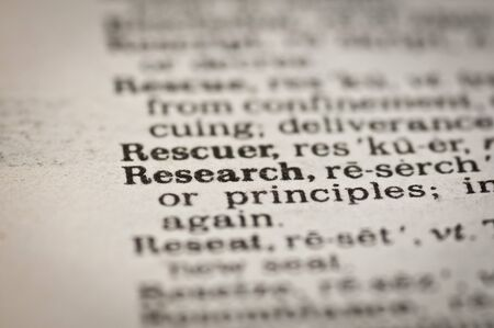 Extreme close up of the word RESEARCH found inside a dictionary Archivio Fotografico
