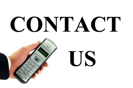 Business man's hand holding out a cordless phone with white space for any text Archivio Fotografico