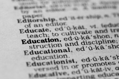 Close Up of Dictionary Definition of Education