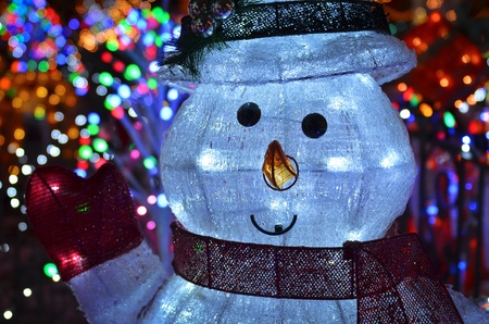 Christmas Concept With Outdoor Snowman Lights At Night Stock Photo