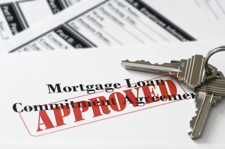 homeownership: Real Estate Mortgage Approved Loan Document With House Keys Stock Photo