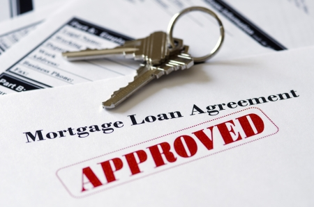 housing loan: Real Estate Mortgage Approved Loan Document With House Keys Stock Photo