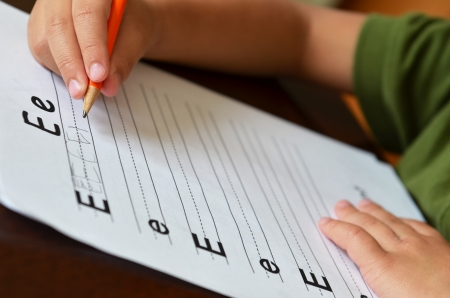 Education Concept With Child's Hand Gripping A Pencil To Write Archivio Fotografico