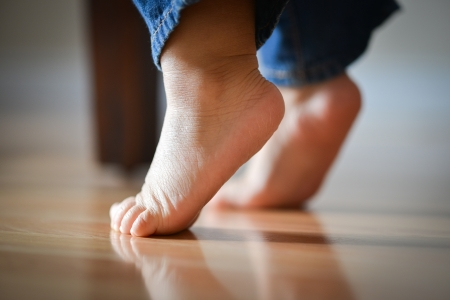 innocence: Infant Child On Tippy Toes - Innocence Concept Stock Photo