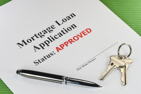 Real Estate Mortgage Approved Loan Document With Pen And House Keys photo