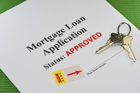 homeownership: Approved Real Estate Mortgage Loan Document Ready For Signature With House Keys Stock Photo