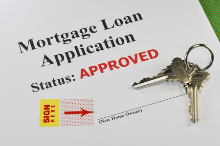 mortgage: Approved Real Estate Mortgage Loan Document Ready For Signature With House Keys Stock Photo