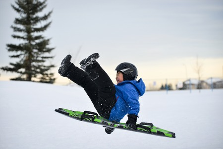 Winter Fun  Child SleddingTobogganing Fast Over Snow Ramp