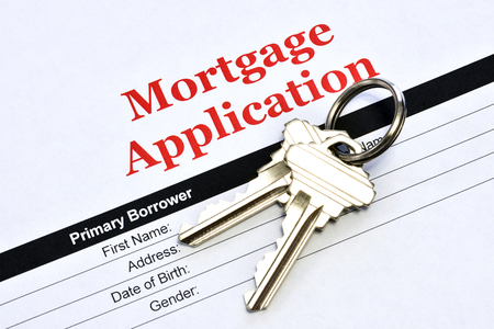 Real Estate Mortgage Application Loan Document With House Keys Archivio Fotografico