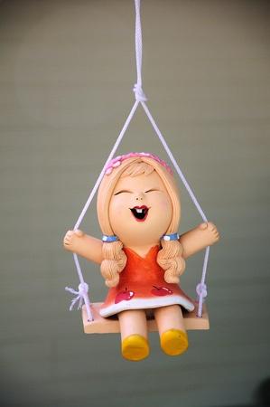 swing seat: Bambola di argilla dondolo