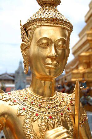 Golden Kinnari statue in Wat Phra Kaew photo