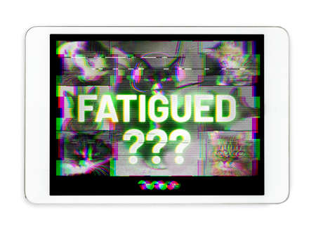"""Tablet screen with the word """"fatigued?"""". Pet or cat themed distorted and pixelated video group chat. Concept for screen fatigue, eye strain, video call exhaustion and virtual class learning problems."""
