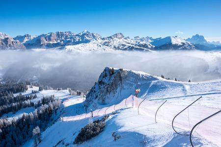A ski slope above clouds, Alta Badia, Italy, Europe Stockfoto