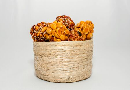 basket with a bunch of typical mexican seeds candies nuts peanuts honey amaranth in circle white background isolated