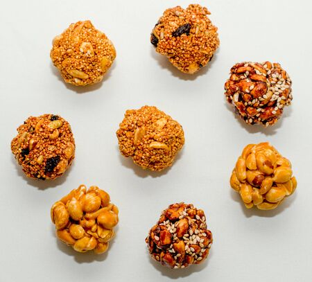 bunch of typical mexican seeds candies nuts peanuts honey amaranth in circle white background isolated