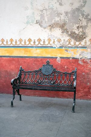 mexican typical metallic antique ancient mexican mexico traditional bench rust colorful wall red yellow green