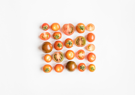 Bright cherry tomatoes in a square on white background. Healthy food for salad. Flat lay, top view, view from above