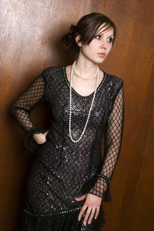 The young woman in black beautiful dress, on neck beads from pearls Stock Photo - 6331320