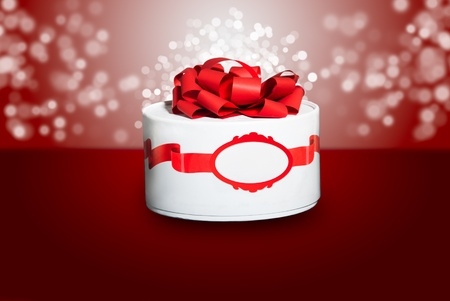 Beautiful colorful red gift with a red background and bokeh.