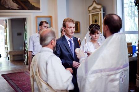 Wedding of newlyweds in the church. Kazakhstan - Almaty, July 18, 2010.