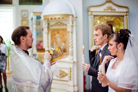 Wedding of newlyweds in the church. Kazakhstan - Almaty, 18 july 2010 Stock Photo - 9364192