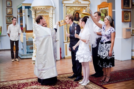 Wedding of newlyweds in the church. Kazakhstan - Almaty, 18 July 2010