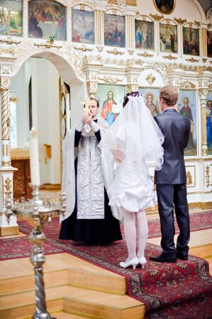 Wedding of newlyweds in the church. Kazakhstan - Almaty, 18 July 2010 Stock Photo - 9364207