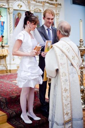 Wedding of newlyweds in the church. Kazakhstan - Almaty, 18 July 2010 Stock Photo - 9364197