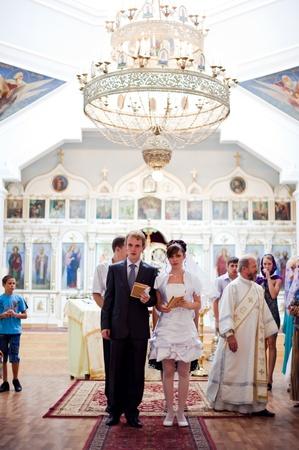 Wedding of newlyweds in the church. Kazakhstan - Almaty, 18 July 2010