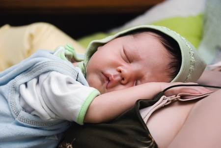 Strong sleeping newborn child Stock Photo - 9943797