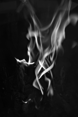 Thick smoke flame tongue on a black background. Stock Photo