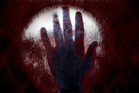 The bloody hand on the dark spooky texture