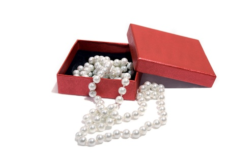 Necklace pearls in a gift box isolated on white background. Stock Photo