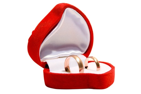 Wedding ring in red gift box isolated on the white background. photo