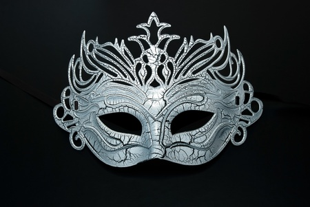 Carnival mask on the black background. photo