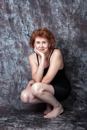 Beautiful adult woman in black dress. Studio shot Stock Photo - 11746511