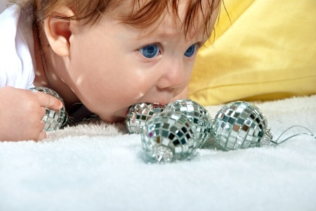 Beautiful portrait of a baby with festive balls. Stock Photo - 12043201