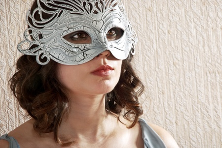 Beautiful woman in black and white masquerade mask. Stock Photo - 12043205