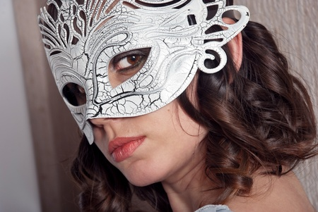 Beautiful woman in black and white masquerade mask. photo