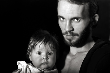 Beautiful black and white portrait of a young father with his son. Nature noise photo