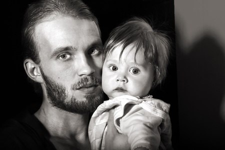Beautiful black and white portrait of a young father with his son. photo